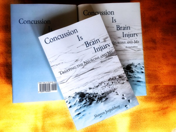 My just delivered paperback and hard covers of Concussion Is Brain Injury in their pretty blue-and-white jackets.