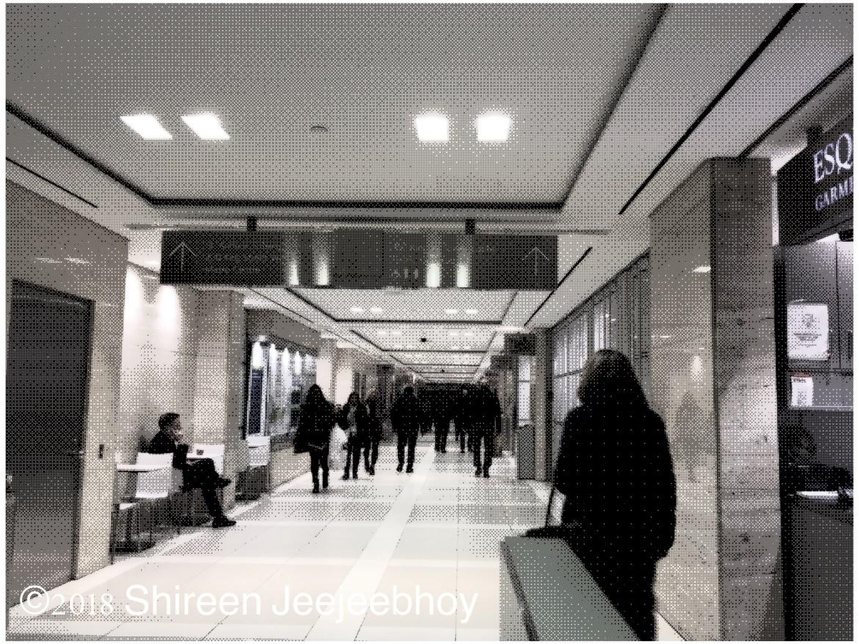 People walking away down PATH system.