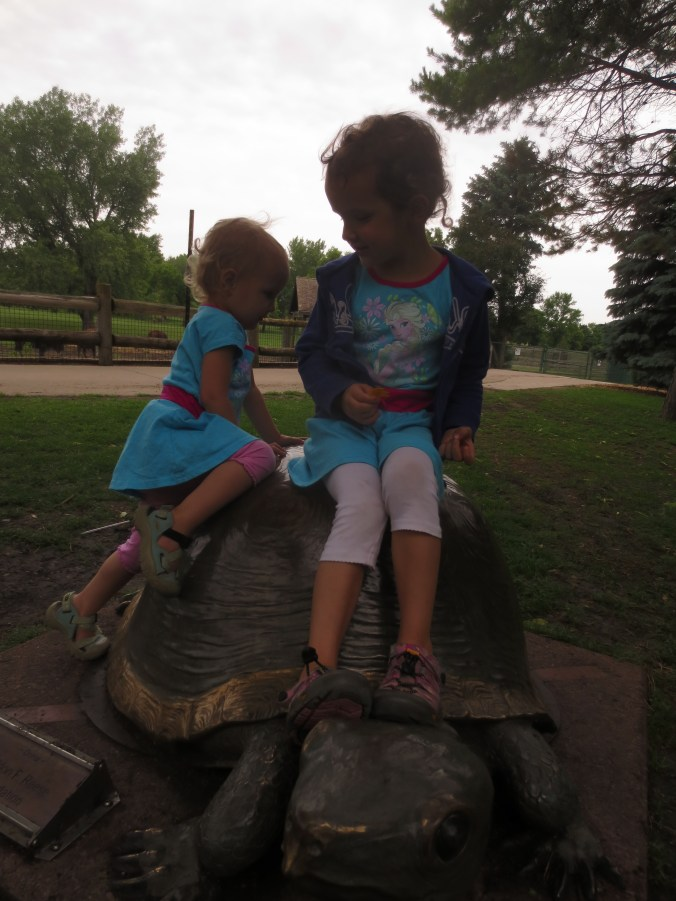 Miriam and Moriah climbing the fake turtle