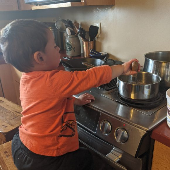 Sam helps cook and explores tools, textures and tastes in the kitchen.