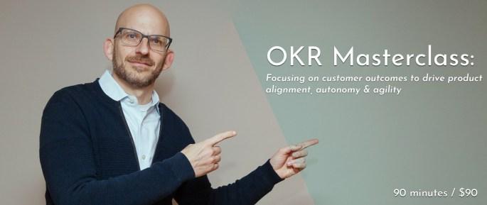Jeff Gothelf pointing towards the OKR Masterclass title