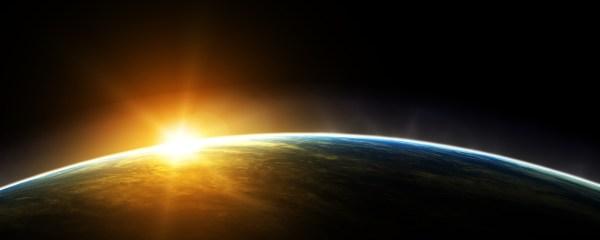 The sun rising over Earth