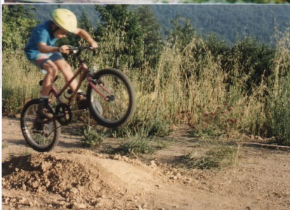 Imitating the neighbor who built jumps for his dirt bike, I loved my little tabletop in the back yard. Elbows out!