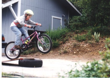 Building tire jumps in 1994. That's my sister's Specialized Hardrock, my department store bike didn't fly as well!