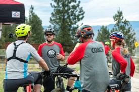 Coaches chat before the kids group ride in Kamloops, B.C.