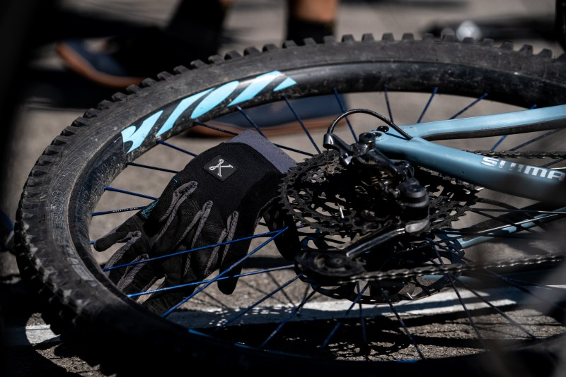 Photo of a wheel from Ibis cycles and a glove from Kitsbow cycling apperal