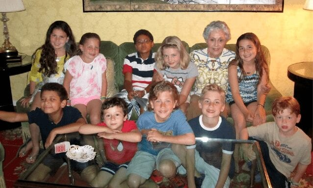 With her 451 great-grandchildren.