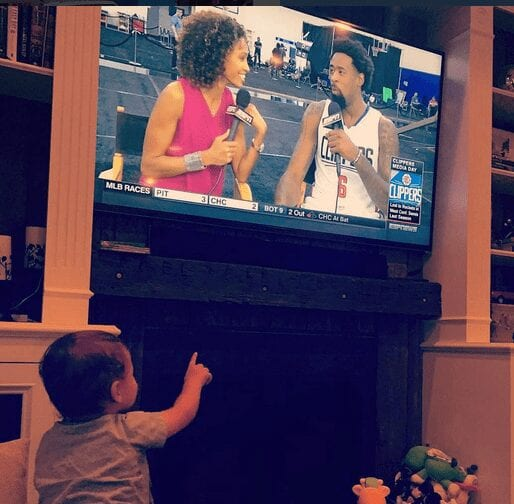 Sage's nephew, Colt, pointing excitedly to either his aunt or the Clippers' center.