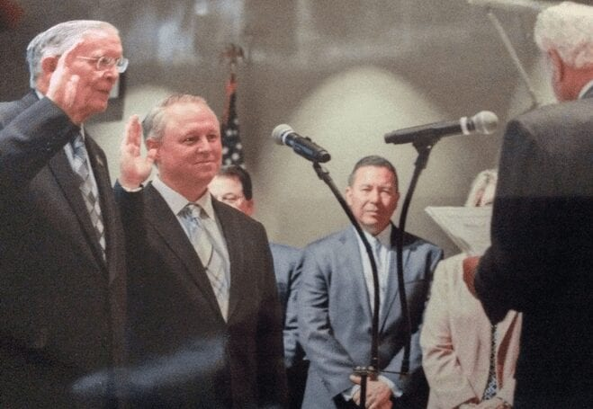 Robinson, second from left, being sworn in to the board of smog lovers.