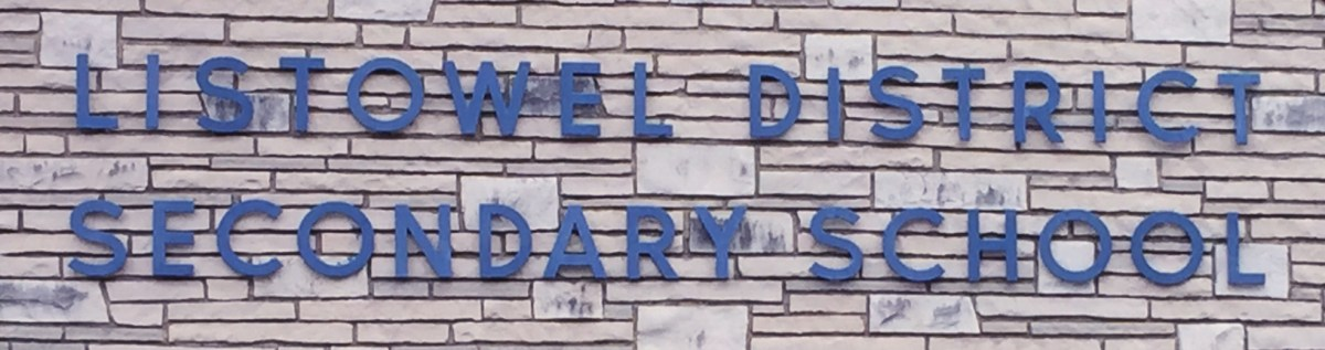 """Listowel District Secondary School"" written in blue on white/grey brick"