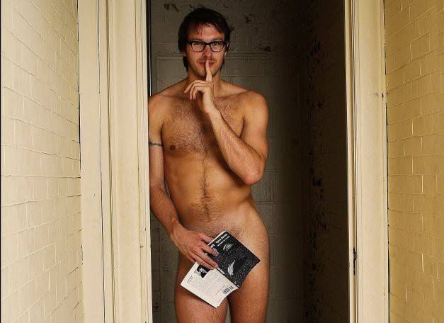 photo of a naked man in a doorway with a book