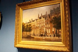 A painting of the canal house, in the canal house.