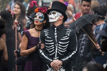 Estrella (Stephanie Sigman) and Bond (Daniel Craig) in the crowds of El Dia de los Muertos procession in Metro-Goldwyn-Mayer Pictures/Columbia Pictures/EON Productions' action adventure SPECTRE. Tolsa Square, Mexico City.