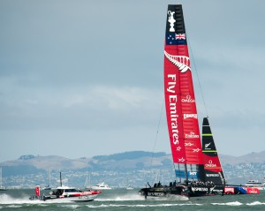 Team New Zealand hydrofoiling catamaran racing downwind