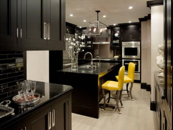 kitchens with black appliances and black countertops