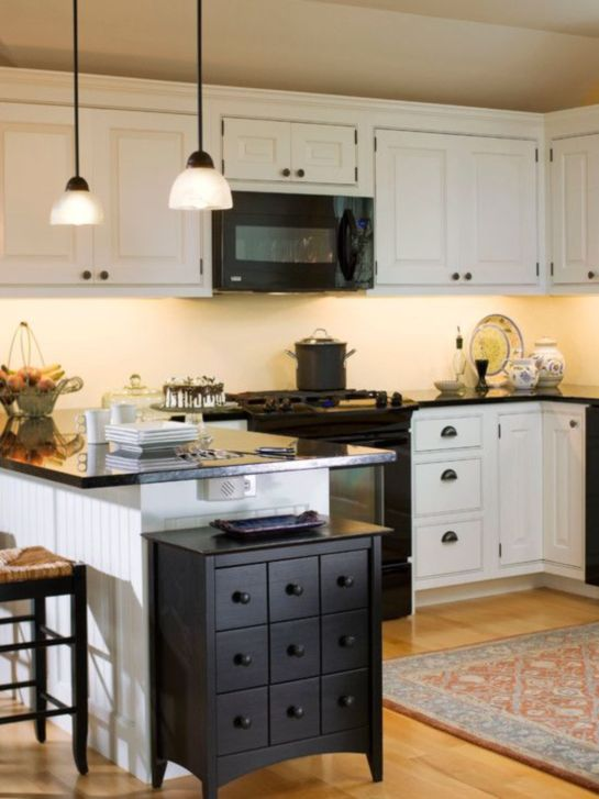 pictures of white kitchens with black appliances