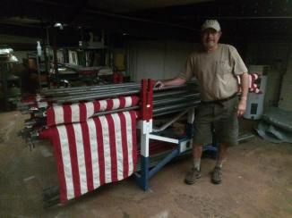 Lion Norm with American flags in the warehouse.