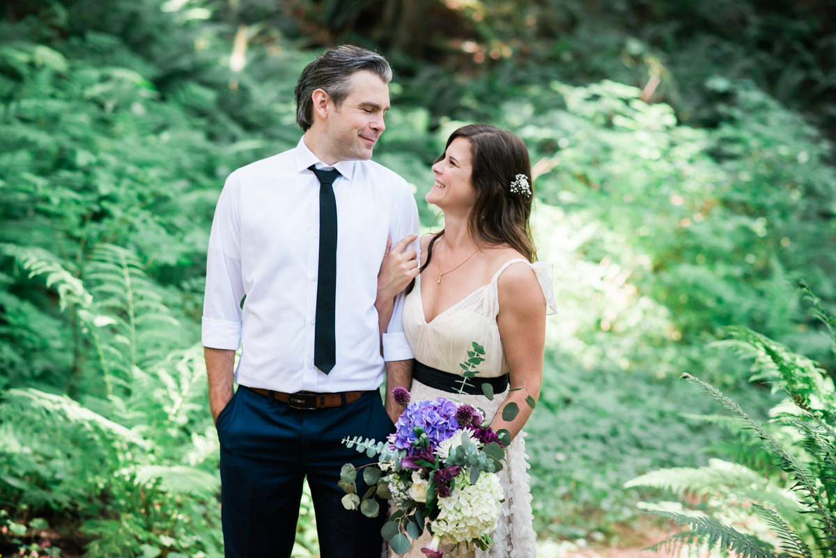 Mission Barn wedding, couple in the greens