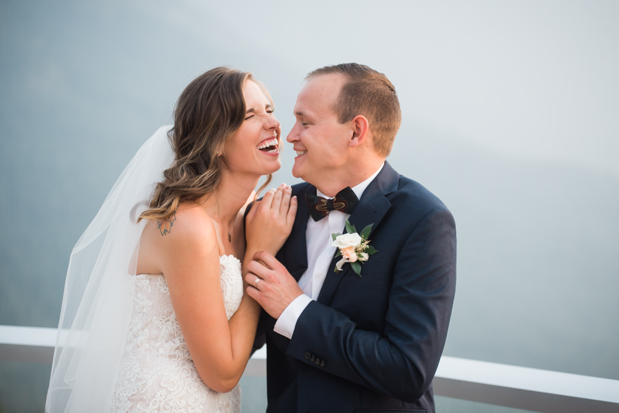 A candid moment between bride and groom at the Sea to Sky Gondola