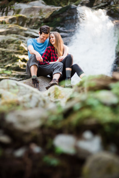 Couple at waterfall in Coquitlam during engagement photo shoot