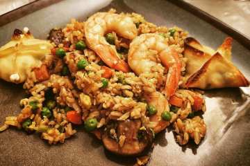 healthy homemade shrimp fried rice made in a wok