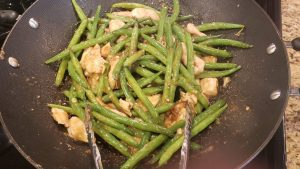 ramen noodles with chinese chicken and string beans in an oyster sauce