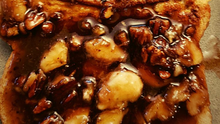 bananas foster french toast easy to make with pecans, brown sugar, bananas, bread, cinnamon, and eggs