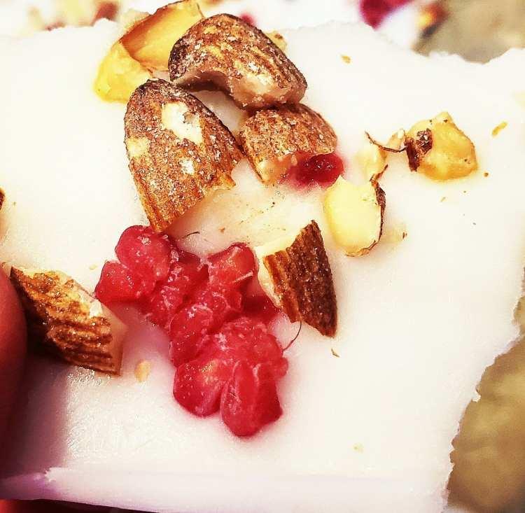 frozen yogurt with vanilla yogurt, toasted coconut almonds and raspberries