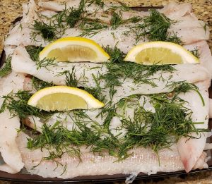 grilled haddock with lemon, dill, salt, and pepper, and melted butter