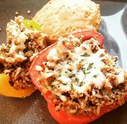 ground turkey stuffed peppers with roasted red pepper quinoa, herbs de provence, sundried tomatoes, and garlic
