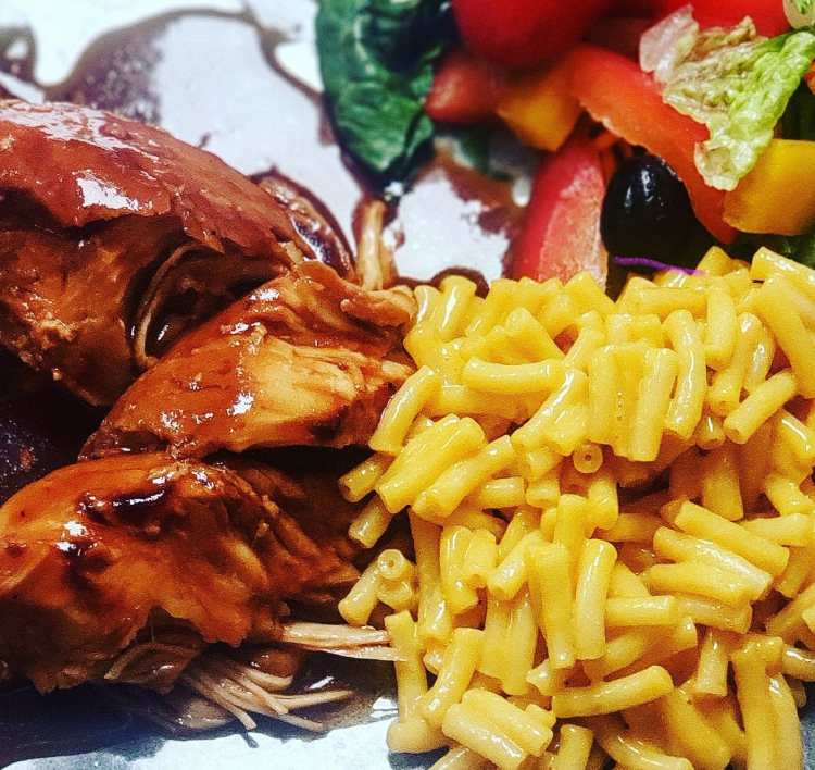sweet baby ray's chicken cooked in the crock pot served with kraft macaroni and cheese and salad
