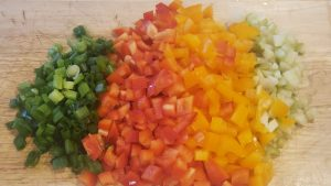 red bell pepper, orange bell pepper, green onions, and celery all diced for the buffalo chicken stuffed spaghetti squash