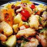 cilantro, lime, shrimp, corn, black beans, cucumbers, cherry tomatoes, red onion, and avocados in a lime vinagrette dressing make up this delicious cilantro shrimp salad