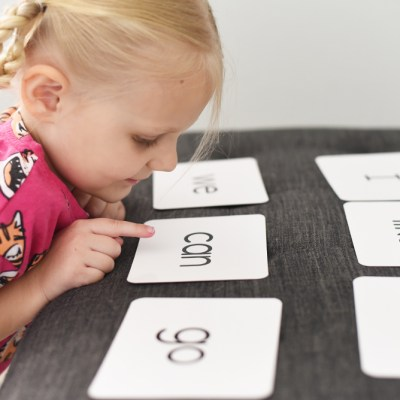 girl looking at sight word flashcards