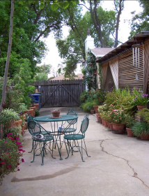 This was the first photo I found of a converted driveway, but I can't find the originator. I love how the plants frame in the driveway, making it look like a much more intentional entertaining space.