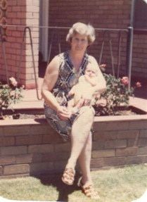 Mum (Patsy) holding her granddaughter Helen at the front of the house