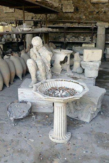 Plaster person of Pompeii sitting