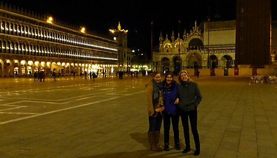 Lexi, Jen, and Barb in St. Mark's Square at night.