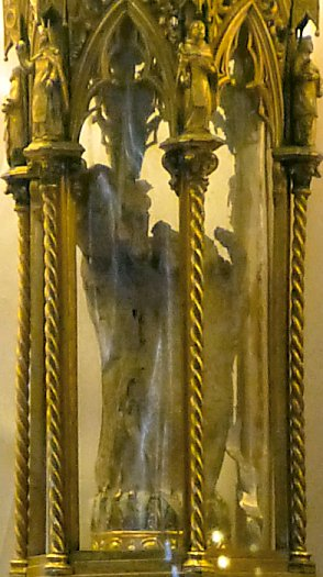 A mummified  foot, purported to be Saint Catherine's, in a decorative glass case.