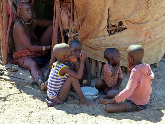 Himba children eat porridge.
