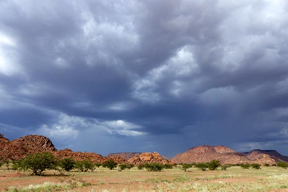Clouds over rocky hills.