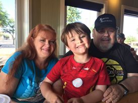 Landon with his grandparents (my mom and dad)