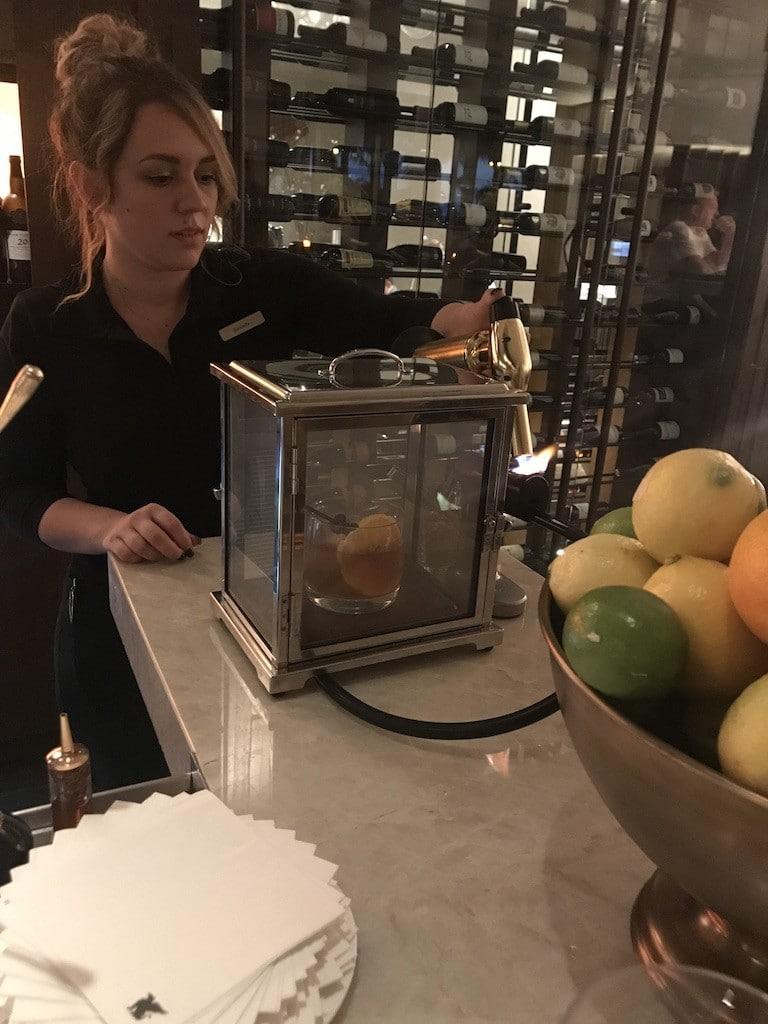 Bar at Ario at the JW Marriott Marco Island. Bartender using Smoking Box.
