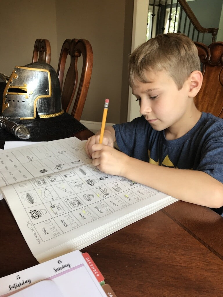 Child working on phonics lesson in Explode the Code. An everyday look at why I love homeschooling!