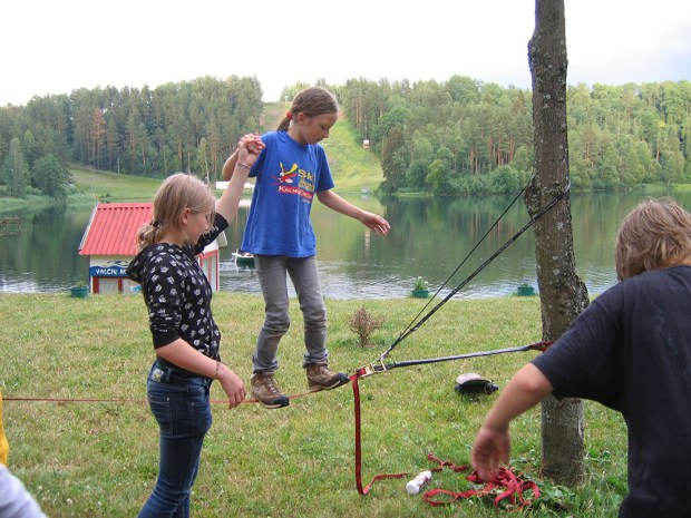 Laura Pamerneckytė (who would be Lithuania's female representative to the first Winter Youth Olympic Games in Innsbruck 2012) helps a younger skier walk the balance rope during summer training in Ignalina.