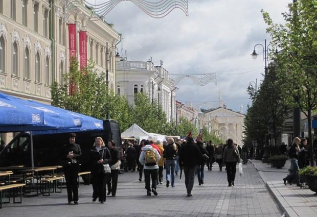 Festival goers walk along Gedimino g. in Vilnius.