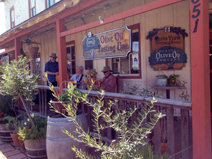 A bluegrass band plays on the porch of the Temecula Olive Oil Company.