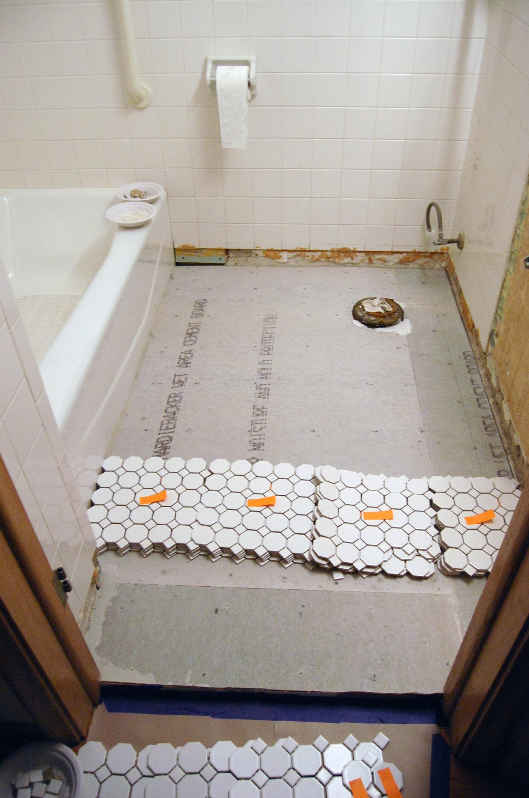 Bathroom Progress: laying some tile – JennBlogsHere