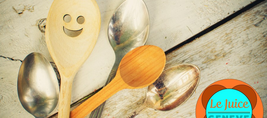 A smiling spoon among regular spoons. Standing out from the crowd. Concept restaurants in Geneva, Switzerland.