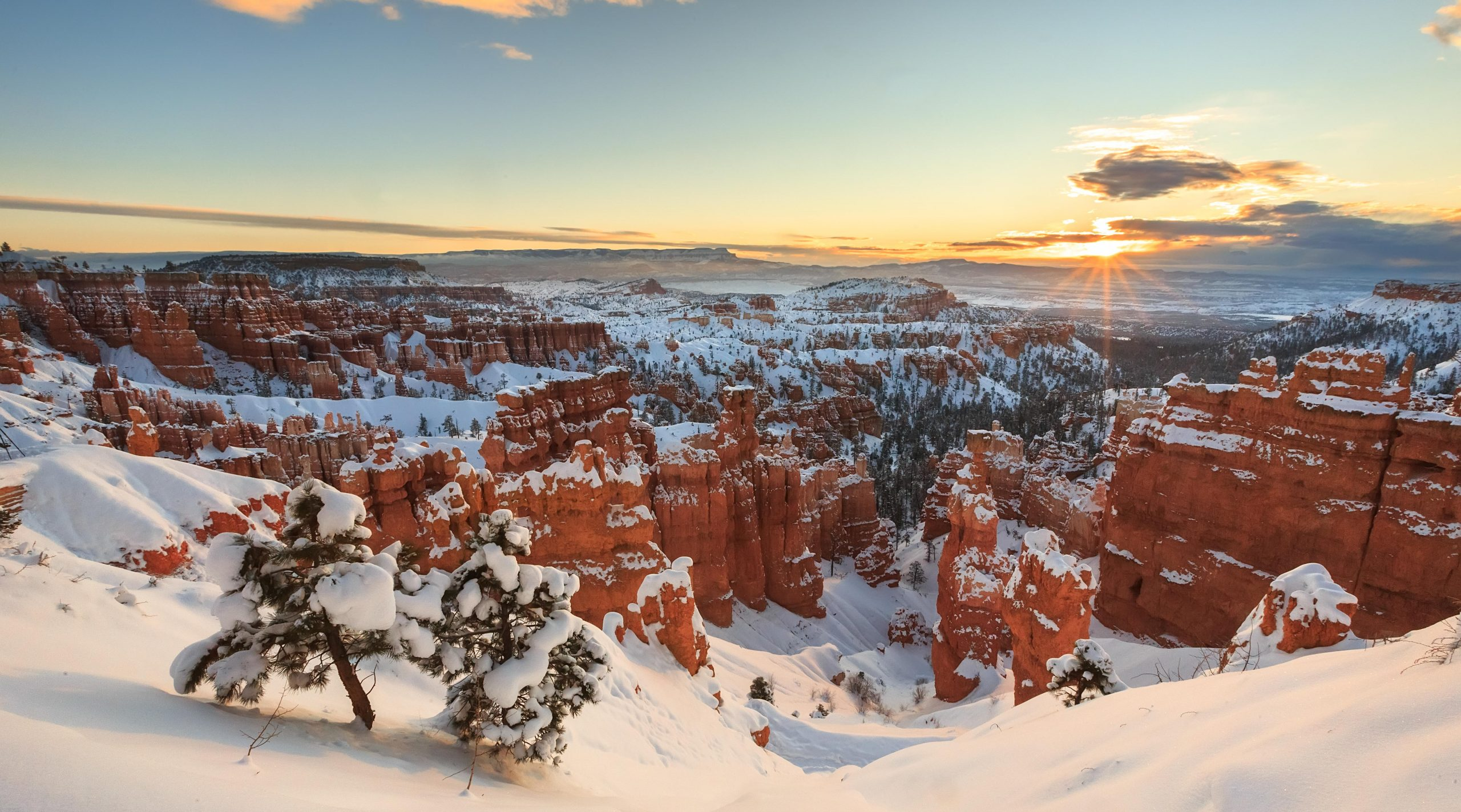 This was the first sunrise after the largest snow storm of the 2014-2015 winter season at Bryce Canyon. The temperatures were cold and the wind was whipping the snow, but the fist rays of sun did not disappoint.